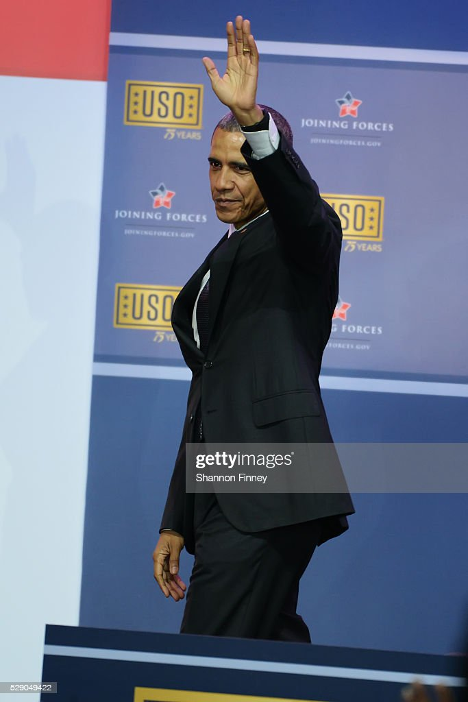 The President waves goodbye to the audience at the 75th Anniversary USO Show on May 5 2016 at Joint Base Andrews in Camp Springs Maryland