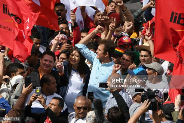 The presidential candidate for Honduras' Opposition Alliance against Dictatorship Salvador Nasralla and his wife Iroshka Elvir take part in a...