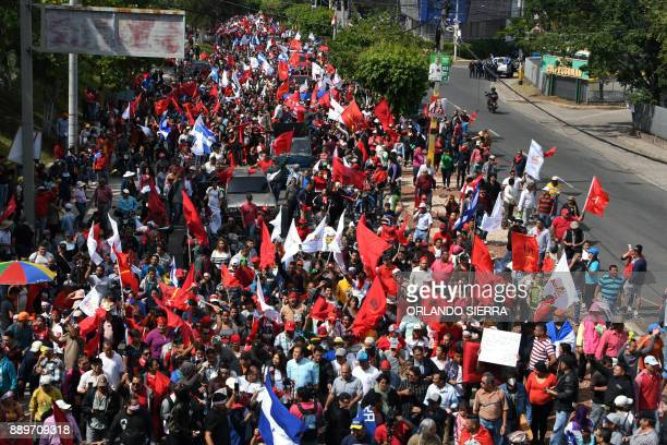The presidential candidate for Honduras' Opposition Alliance against Dictatorship Salvador Nasralla marches with supporters during a demonstration in...