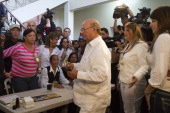 The presidential candidate for the Dominican Revolutionary Party Hipolito Mejia gets ready to cast his vote at a polling station in Santo Domingo on...