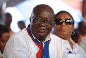 The presidential candidate of the opposition New Patriotic Party Nana AkufoAddo smiles next to his wife Rebecca during the final rally of the party...