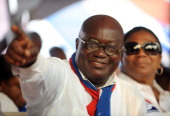 The presidential candidate of the opposition New Patriotic Party Nana AkufoAddo gestures next to his wife Rebecca during the final rally of the party...