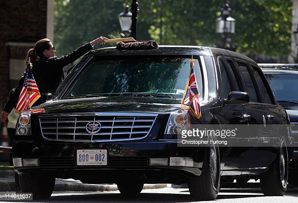 The Presidential car nicknamed 'The Beast' is cleaned by its driver as US President Barack Obama visits British Prime Minister David Cameron at...