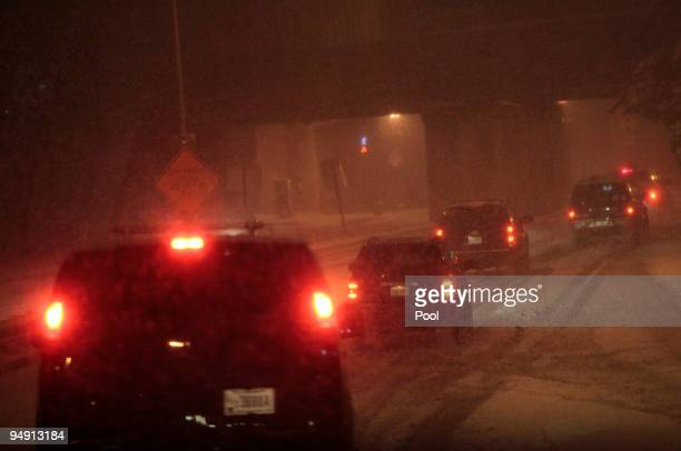 The presidential motorcade drives to the White House after US President Barack Obama arrived on Air Force One at Andrew Air Force Base on December 19...