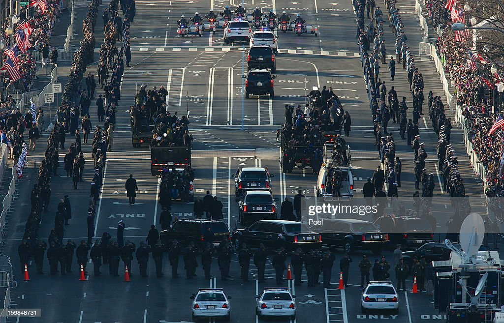 The presidential motorcade takes part in the inaugural parade on its way down Pennsylvania Avenue from the U.S. Capitol on January 21, 2013, in Washington, DC. U.S. President Barack Obama and Vice President Joe Biden were sworn in for a second term.