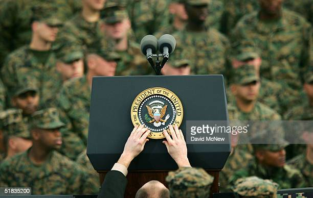 The presidential seal is placed on the podium prior to US President George W Bush speech to Marines during his visit on the 63rd anniversary of the...