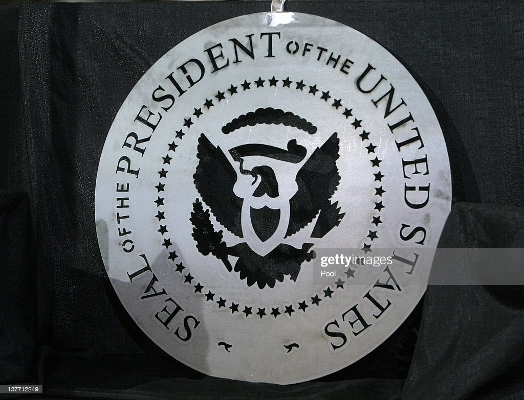 The Presidential seal was cut using a plasma cutter lays on the stage as President Barack Obama speaks at Conveyor Engineering & Manufacturing January 25, 2012 in Cedar Rapids, Iowa. Obama, who is on a three-day tour, spoke about manufacturing and the economy during the speech.