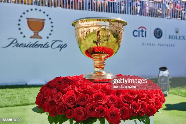 The Presidents Cup Trophy surrounded by roses sits at the first tee during the first round of the Presidents Cup at Liberty National Golf Club on...