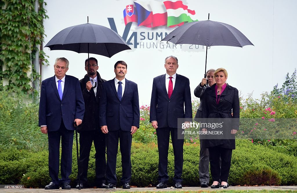 The Presidents of the Visegrad countries (V4, L-R) Milos Zeman of the Czech Republic, Janos Ader of Hungary, Andrej Kiska of Slovakia and the Croatian President Kolinda Grabar-Kitarovic pose for a picture as they arrive for an official welcoming ceremony in Balatonfured on October 8, 2015. Their talks are expected to focus on the migrants' situation, the climate change and the situation in the Western Balkans. The Polish President Andrzej Duda is expected to join the group later in the day. AFP PHOTO / ATTILA KISBENEDEK