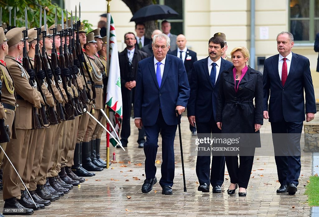 The Presidents of the Visegrad countries (V4) Milos Zeman (L) of the Czech Republic, Janos Ader (2nd L) of Hungary, Andrej Kiska (R) of Slovakia and the Croatian President Kolinda Grabar-Kitarovic (2nd R) inspect a military honor guard during an official welcoming ceremony in Balatonfured on October 8, 2015. Their talks are expected to focus on the migrants' situation, the climate change and the situation in the Western Balkans. The Polish President Andrzej Duda is expected to join the group later in the day. AFP PHOTO / ATTILA KISBENEDEK