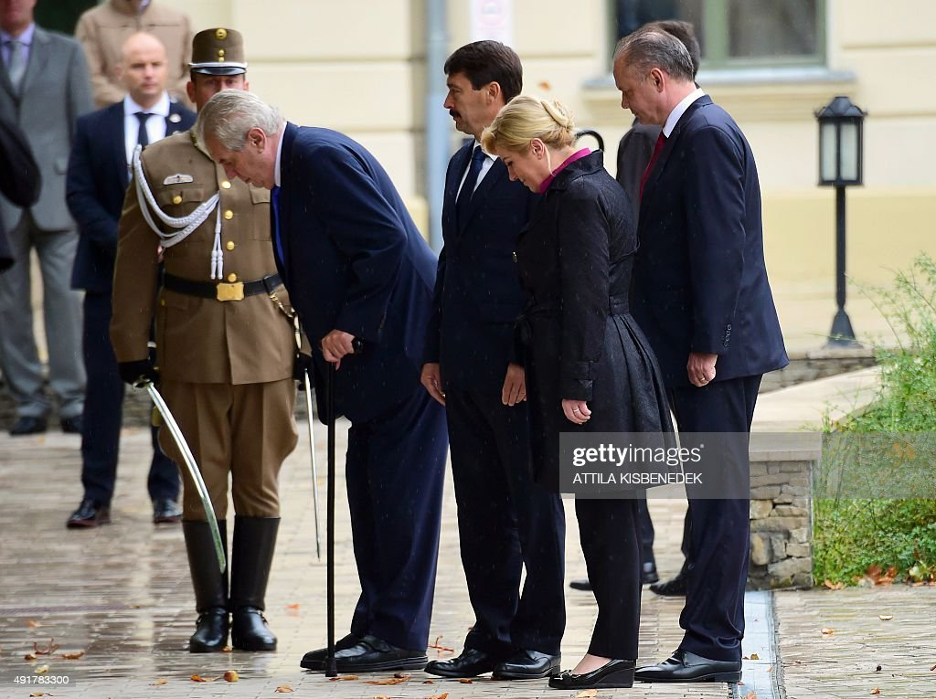 The Presidents of the Visegrad countries (V4) Milos Zeman (L) of the Czech Republic, Janos Ader (2nd L) of Hungary, Andrej Kiska (R) of Slovakia and the Croatian President Kolinda Grabar-Kitarovic (2nd R) inspect a military honor guard during an official welcoming ceremony in Balatonfured on October 8, 2015. Their talks are expected to focus on the migrants' situation, the climate change and the situation in the Western Balkans. The Polish President Andrzej Duda is expected to join the group later in the day.
