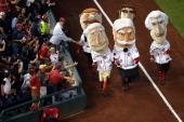 The President's Race occurs during an MLB game between the Cincinnati Reds and the Washington Nationals at Nationals Park on May 20 2014 in...
