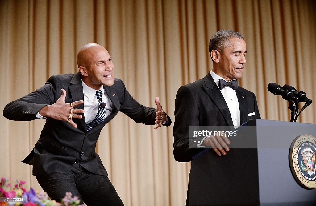 The presidents translator, Luther (L), as portrayed by comedian Keegan-Michael Key, gestures as President Barack Obama speaks at the annual White House Correspondent's Association Gala at the Washington Hilton hotel April 25, 2015 in Washington, D.C. The dinner is an annual event attended by journalists, politicians and celebrities.