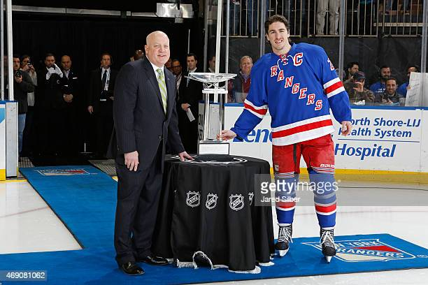 The Presidents Trophy is presented by NHL Deputy Commissioner Bill Daly to Ryan McDonagh of the New York Rangers prior to the game against the Ottawa...
