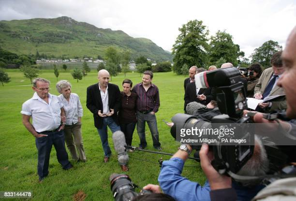 The press speak with freed BBC journalist Alan Johnston after he is reunited with family members sister Katriona brotherinlaw Raymond Hogg and...