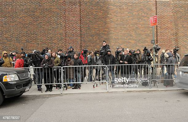 The press waits at The scene outside the Chelsea apartment building on March 17 2014 in New York City where fashion designer L'Wren Scott was found...