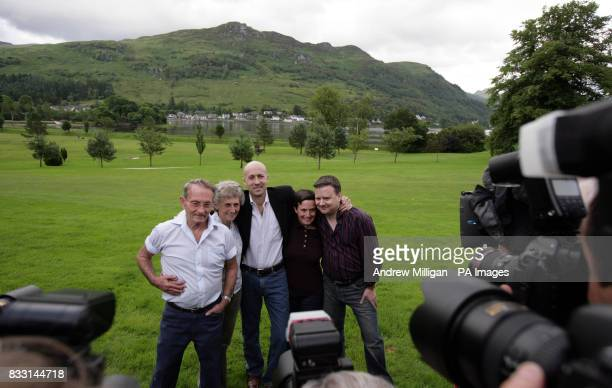 The press with freed BBC journalist Alan Johnston after he is reunited with family members sister Katriona brotherinlaw Raymond Hogg and parents...