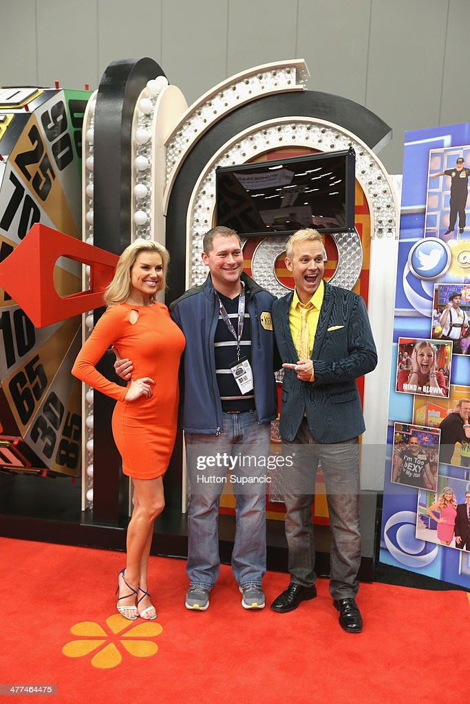'The Price is Right' model Rachel Reynolds and host <a gi-track='captionPersonalityLinkClicked' href=/galleries/search?phrase=George+Gray&family=editorial&specificpeople=560149 ng-click='$event.stopPropagation()'>George Gray</a> with contestants during the 'The Price is Right' pop-up at 2014 SXSW Music, Film + Interactive Festival on March 9, 2014 in Austin, Texas.