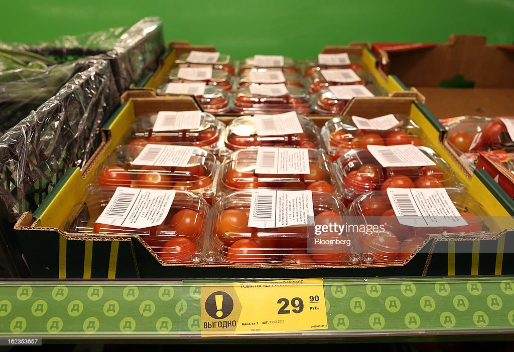 The price of boxes of tomatoes is dislayed in rubles on a shelf in the fruit and vegetable section of a supermarket operated by OAO Dixy Group in Moscow, Russia, on Friday, Feb. 22, 2013. Russia's largest retailer by market value, OAO Magnit, is spending as much as $1.8 billion this year to compete against X5 Retail Group NV and OAO Dixy Group. Photographer: Andrey Rudakov/Bloomberg via Getty Images