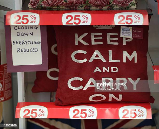 The price of cushions with the war time slogan 'Keep Calm And Carry On' are reduced in a closing down sale at a Past Times store in Bury which closes...