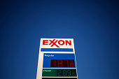The price of unleaded gasoline is advertised at an Exxon Mobil Corp gas station in Portland Tennessee US on Friday Jan 16 2015 Trips to the pump that...