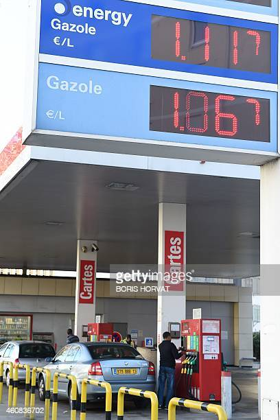 The prices of oil are seen at a gas station on December 26 2014 in Marseille southeastern France Oil prices have fallen about 50 percent since June...