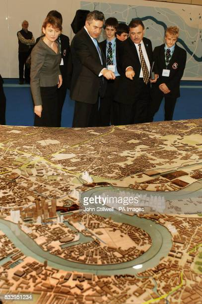 The Prime Minister Gordon Brown studies a giant model with Yvette Cooper the Housing Minister and David Taylor the Chairman of TGF at the ExCel...