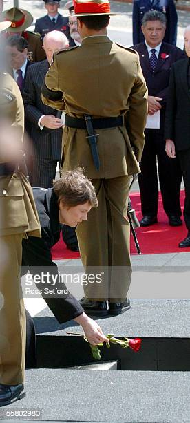 The Prime Minister Helen Clark places a red rose in the tomb of the unknown warrior at the National War Memorial Wellington New Zealand Wednesday...