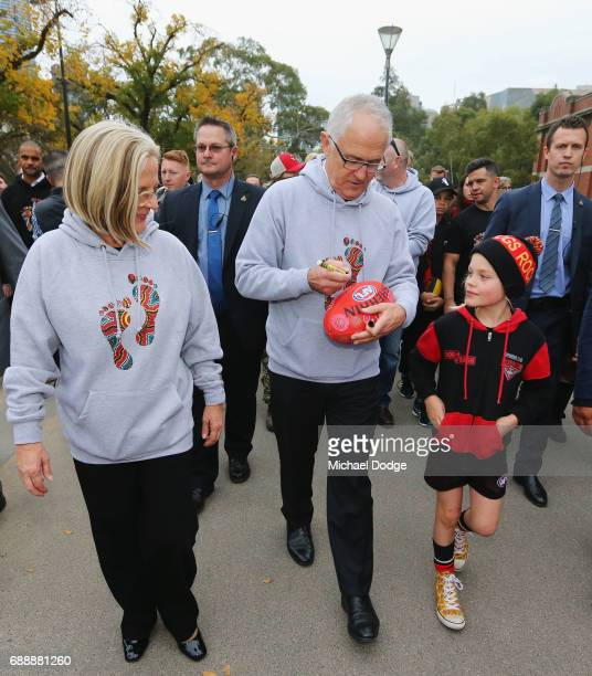 The Prime Minister Malcom Turnbull and his wife Lucy Turnbull join fans for The Long Walk before the round 10 AFL match between the Richmond Tigers...