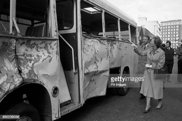 The Prime Minister Margaret Thatcher looking at the Army coach its side badly dented and with nails embedded in the bodywork in Ebury Bridge Road...