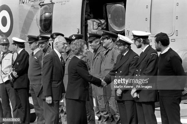The Prime Minister Margaret Thatcher meeting the rescue helicopter crews on a helipad in the grounds of Aberdeen Royal Infirmary today after her...