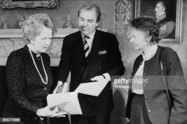 The Prime Minister Margaret Thatcher receives the deeds of Cape Cornwall on behalf of the National Trust from Dr Tony O'Reilly president of the Heinz...