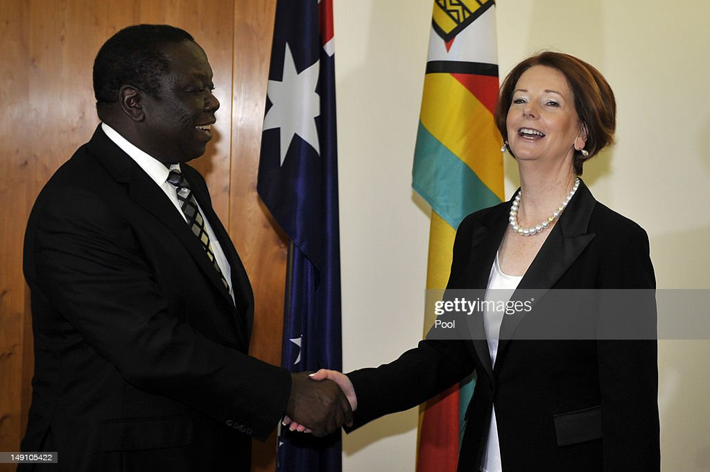 The Prime Minister of Australia <a gi-track='captionPersonalityLinkClicked' href=/galleries/search?phrase=Julia+Gillard&family=editorial&specificpeople=787281 ng-click='$event.stopPropagation()'>Julia Gillard</a> shakes hands with the Prime Minister of Zimbabwe <a gi-track='captionPersonalityLinkClicked' href=/galleries/search?phrase=Morgan+Tsvangirai&family=editorial&specificpeople=800701 ng-click='$event.stopPropagation()'>Morgan Tsvangirai</a> during a meeting at Parliament House on July 23, 2012 in Canberra, Australia. Australia is the third largest donor to Zimbabwe with assistance focused on water, sanitation and economic growth.