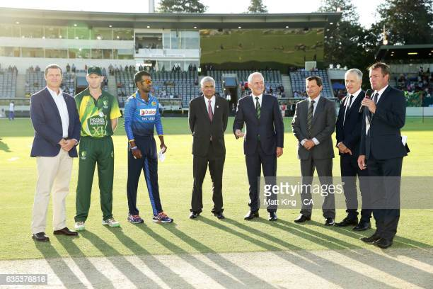 The Prime Minister of Australia Malcolm Turnbull and Sri Lankan Prime Minister Ranil Wickremesinghe take part in the coin toss alongside Adam Voges...