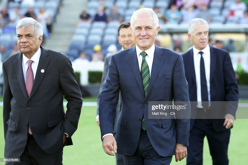 The Prime Minister of Australia Malcolm Turnbull (R) and Sri Lankan Prime Minister Ranil Wickremesinghe (L) walk out to take part in the coin toss during the T20 warm up match between the Australian PM's XI and Sri Lanka at Manuka Oval on February 15, 2017 in Canberra, Australia.
