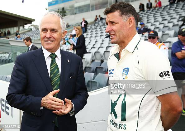 The Prime Minister of Australia Malcolm Turnbull talks with the Prime Minister's XI captain Michael Hussey before the tour match between the Prime...