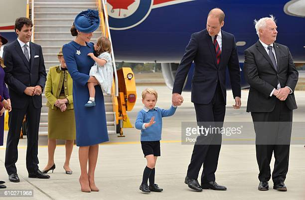 The Prime Minister of Canada Justin Trudeau watches after greeting Prince William Duke of Cambridge Catherine Duchess of Cambridge Prince George of...