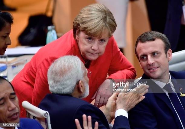 The Prime Minister of India Narendra Modi German Chancellor Angela Merkel and French President Emmanuel Macron speak together when they arrive for...