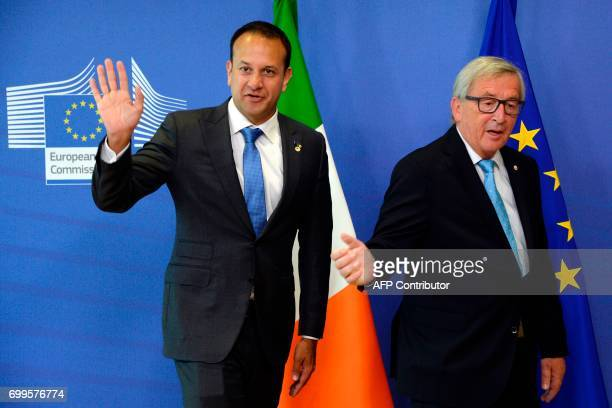 The Prime Minister of Ireland Leo Varadkar and European Union Commission President JeanClaude Juncker gesture as they arrive prior to their meeting...