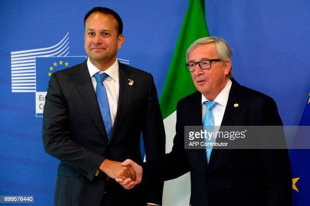 The Prime Minister of Ireland Leo Varadkar shakes hands with European Union Commission President JeanClaude Juncker prior to their meeting at the...