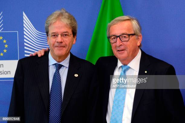 The Prime Minister of Italy Paolo Gentiloni and European Union Commission President JeanClaude Juncker pose prior to their meeting at the European...