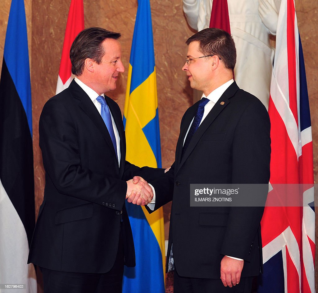 The Prime Minister of Latvia Valdis Dombrovskis (R) shake hands with his British counterpart David Cameron (L) prior to the Northern Future Forum in Riga on February 27, 2013. The Northern Future Forum is an annual, informal meeting of prime ministers, policy innovators, entrepreneurs and business leaders from 9 nations.