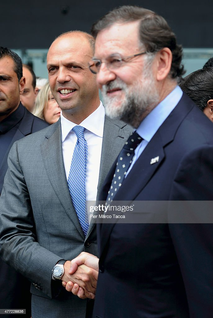 The Prime Minister of Spain Mariano Rajoy shakes hands with Italian Interior Minister Angelino Alfano during his visit to the Spanish Pavilion at the...