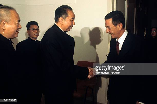 The Prime Minister of the State Council of the People's Republic of China Hua Guofeng shaking hands with the general secretary of Italian Communist...