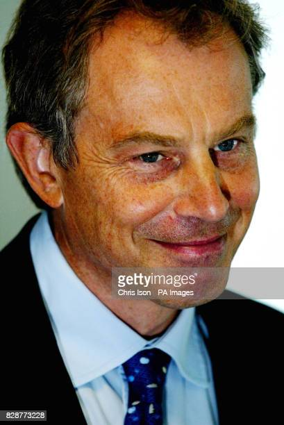 The Prime Minister Tony Blair during his visit with the Home Secretary David Blunkett to the asylum screening unit in Croydon South London A pilot...