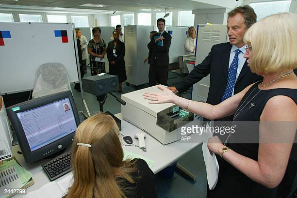 The Prime Minister Tony Blair is shown the finger printing bureau by it's manager Sue Caulfield 27 August 2003 during his visit with the Home...