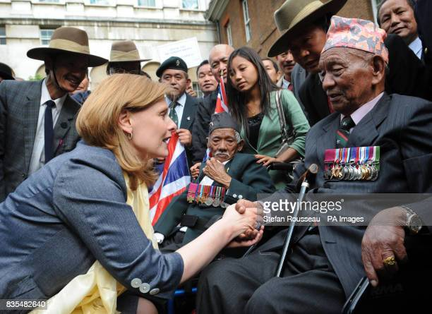 The Prime Minister's wife Sarah Brown meets Gurkhas including Tul Bahadur Pun VC in the garden of Downing Street today after it was announced that...