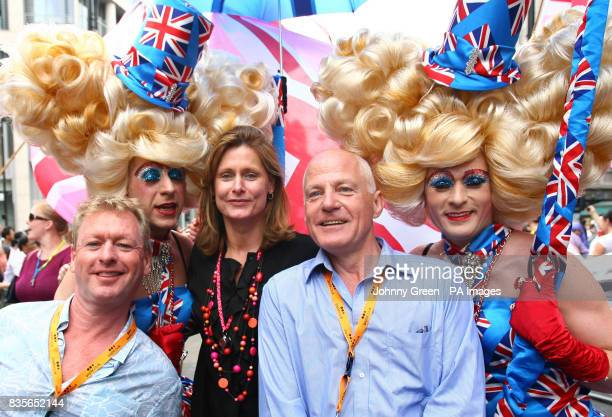 The Prime Minister's wife Sarah Brown stops for a picture with former Eastenders actor Michael Cashman right and his partner Paul Cottinghamleft as...
