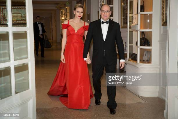 the Prince Albert and the princess Charlenne of Monaco at the Laureus World Sport Award at the Hotel Hermitage in MonteCarlo Charlene wearing a red...