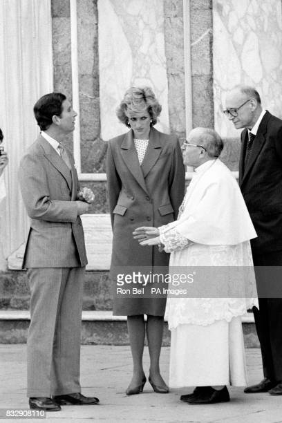 The Prince and Princess of Wales chat to Abbot Monsignor Aldinucci at the church of San Miniato in Florence